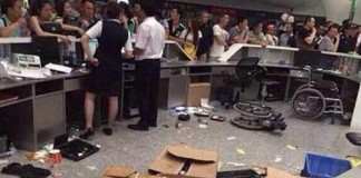 China Passengers Throw Meal Boxes and Water Bottles over Airport Service Counter Talk Cock Sing Song