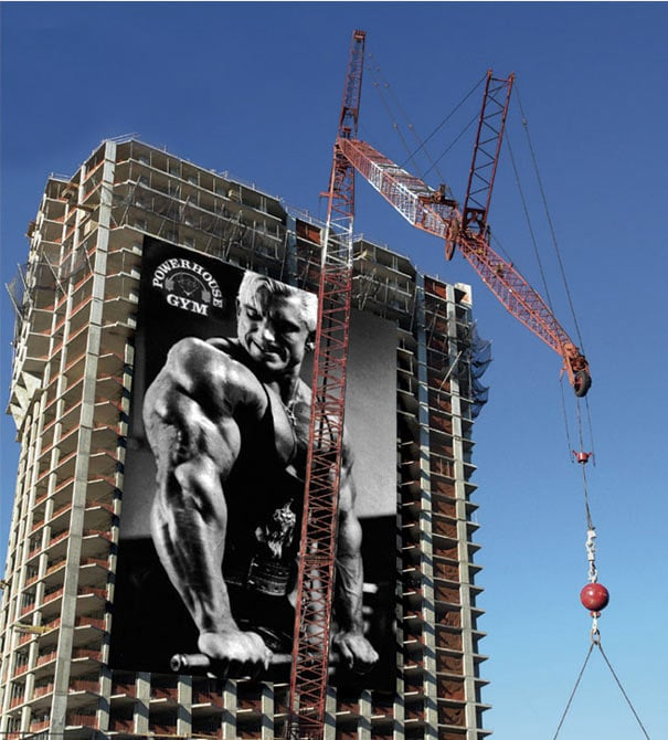 Powerhouse Gym Man Lifting Billboard Ad Talk Cock Sing Song