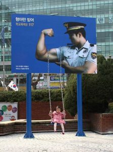 South Korea Join the Police Force Billboard Ad Talk Cock Sing Song